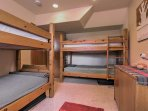 Perfect for kids, this room has 2 twin-over-twin bunk beds.