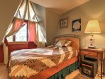 Rejuvenate after a long day of hiking in this queen bed.