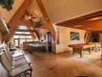 A game room with a ping pong table, pool table, and foosball table provides lots of fun for everyone!