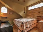 Rest easy in this queen bed.