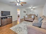 Gather in the living room and watch a movie on the 43-inch flat-screen cable TV.