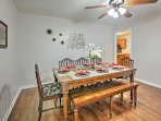 The charming dining table seats up to 8 guests.