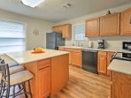 The kitchen island features seating for 3.