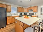 The fully equipped kitchen features modern updates and appliances.