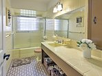 This full bathroom is spacious and ample counter space makes it easy to share with guests.