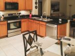The kitchen features brand new black granite countertops!