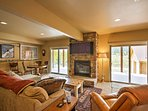Flip the switch for the gas-burning fireplace before settling in for a movie night.