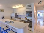 Prepare meals in the fully equipped granite kitchen, complete with stainless steel appliances.