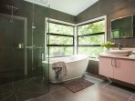 Family bathroom with freestanding bath and shower.