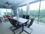 Screened Porch also Has Dining Table