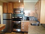 Completely Renovated and Fully Equipped Kitchen with Stainless Appliances and Granite Countertops