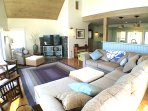 Large living space with comfy seating and flat screen smart tv- a great space to relax.