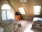 The 'cousins' loft bedroom has 2 full size beds, each with a single trundle, and beautiful views!