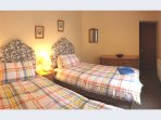 Master bedroom has choice of a super kingsize bed or two extra-long singles
