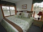 Master Bedroom: Pillowtop King Bed, Flat Screen TV.