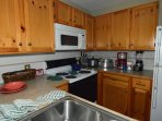 Spacious kitchen, all the serviceware and cookware you'll need.