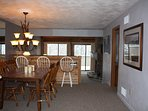 From the dining room that seats seven, step down into the sunken living room.