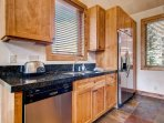 The kitchen features granite countertops and has all the things you'll need to cook up a great meal.