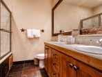 The private bathroom to Master Bedroom #1 has a double vanity and a jetted tub/shower combo.