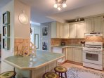 Lower level kitchen with sit to island.