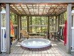 Hot tub with covered gazebo.