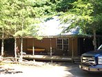 Guest cabin with living area, full bath and kitchen on main floor. Bedroom in loft.