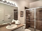 Wash up before bed in this private en-suite bathroom.