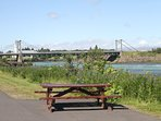 Surrounding area. Olfusa-river. Picnic table by the river.
