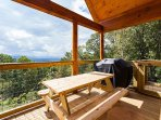 Enjoy grilling out and relaxing on the back deck of Moondance.