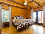 Master bedroom with a walk out to the hot tub.