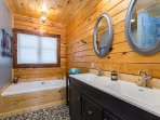 Master bath with double vanity and large soaker tub.