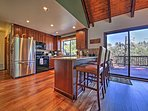 New hardwood floors and carpet meet your feet throughout the rustic house.