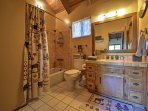Rinse off for the day in the master en-suite bathroom.