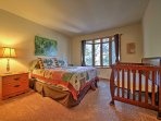 The third bedroom offers a queen bed and crib.