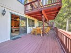 The lower deck offers a fire pit surrounded by Adirondack chairs.