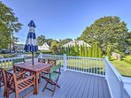 The property features a lovely deck with outdoor furnishings that overlooks the yard.