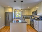 The fully equipped kitchen  features stainless steel appliances and ample counter space.
