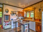 Cook a hearty feast in the fully equipped kitchen with updated appliances and amenities.