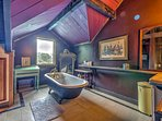 The master en-suite bathroom has a charming antique claw tub to wash up after a day exploring the hillside.