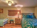 Siblings or friends will look forward to sharing the fifth bedroom, which features a queen bed and twin bed with a...