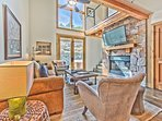 Living Room with Cozy Mountain Contemporary Furnishings, Gas Fireplace, Large Smart TV and Private Patio with Patio...