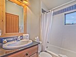 Shared Full Bathroom with Tub/Shower Combo