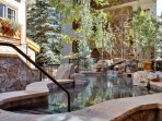 Complimentary access to the grotto-style hot tub next door at The Willows.