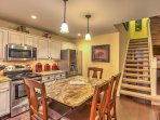 The fully equipped kitchen features updated appliances, granite countertops and a large center-island that seats 4.