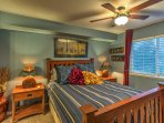 The master bedroom offers a comfortable queen-sized bed and an en-suite bathroom.