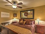 This bedroom boasts a plush king-sized bed.