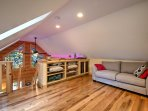 The loft overlooks the great room and sleeps 2 additional guests on a sleeper sofa.