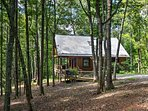 This home is situated on 24 acres of sustainable farmland and is less than 20 miles from Asheville!