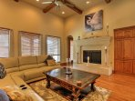 Settle down on the plush sectional in the living area, complete with beautiful paintings and a decorative fireplace.