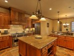 The kitchen is a chef's dream with all of the necessary cookware and ample counterspace!